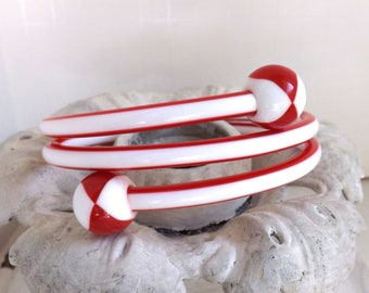 Vintage red and white lucite striped spiral twist bangle bracelet quadrant beach ball knobs or balls on ends by Best Plastics