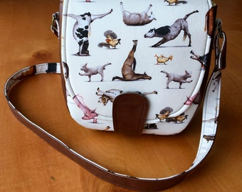 Yoga animals shoulder/saddle bag with magnetic snap and front flap closure, large exterior slip pocket, interior zip pocket - Swoon Sandra