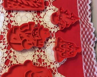 Five Red Vintage Plastic Cookie Cutters