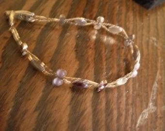Pearl and purple beaded bracelet