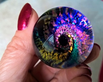 Dichroic vortex art glass marble, rainbow colours with exceptional vibrance, depth and magnification.