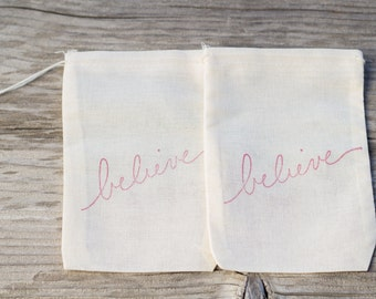 Set of 10  Hand stamped Believe Party Muslin Gift Party Favor Bags 100% organic made in america