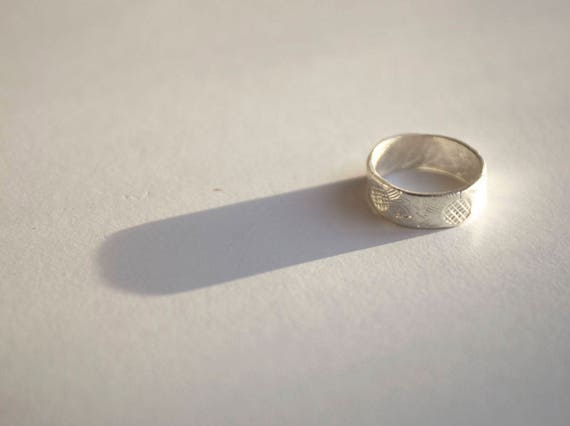 Hand-Fashioned Pure Silver Ring. Embossed with a sunflowers, patterned inside. One of a kind.