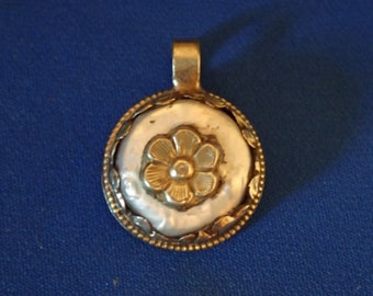 Flower on mother of Pearl in Tibetan silver