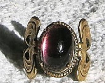 An Art Deco Style Ring with Translucent Purple Cabochon