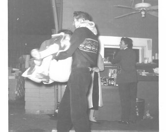 """Vintage Snapshot """"Swept Her Off Her Feet"""" Laughing Man Lifts Woman Off The Floor Wild Party 1950's Black & White Found Vernacular Photo"""