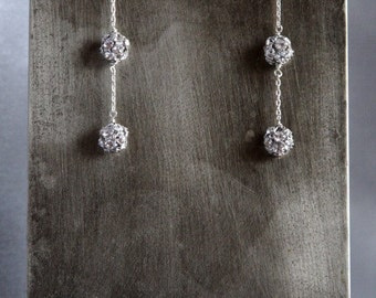 Long, dangling earrings