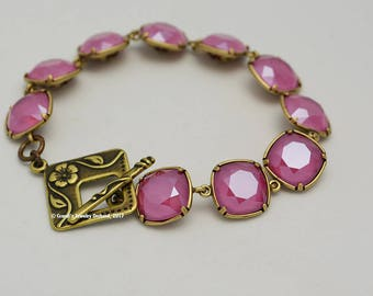Swarovski Cushion Bead Bracelet in Fuschia and Antiqued Brass. One of a kind, handmade bracelet. 12mm crystals in bezel settings. Stunning.