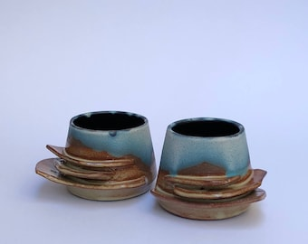 Pair of stoneware whiskey cups blue and brown