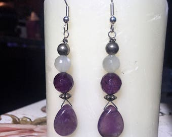 Purple amethyst teardrop earrings with purple amethyst bead and moonstone bead wite wrapped with sterling silver beads.