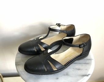 Ferragamo Black Leather T Strap Mary Janes. Free Shipping.