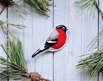 hand embroidered red bullfinch handmade jewelry from threads