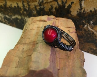 Black wire wrapped ring with red bead