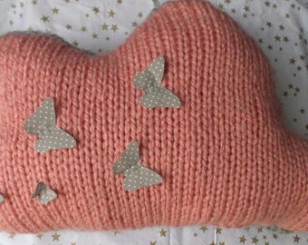 Handknitted pink and gray cloud shaped cushion