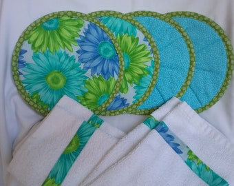 4 hot pads/pot holders with 2 fabric trimmed terry towels