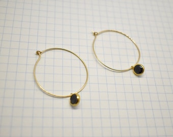 Gold filled hooped earrings with black cubic zirconia.