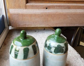 Celadon boxes with green spots and  scratch on the stopper