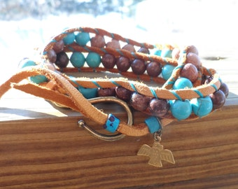 16 inch double wrap bracelet with natural deerskin, waxed ebony beads, turquoise howlite beads, tierra cast antique hook & tribal bird charm