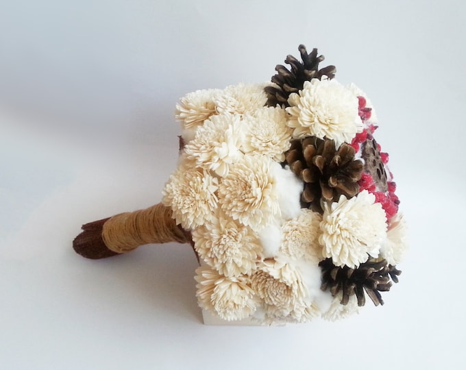 big rustic wedding BOUQUET Cream Flowers pine cones bell cup cotton red frozen berries winter woodland wedding sola roses
