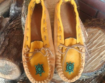 moccasins double rubber sole. rubber bottom sole with leather sole and moosehide upper with beaded turtle