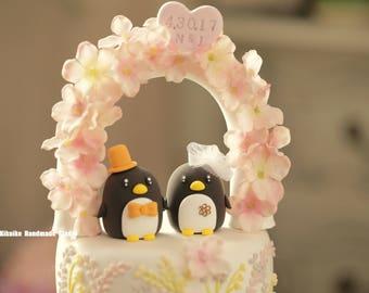 Penguins with swarovski crystal flower wedding cake topper