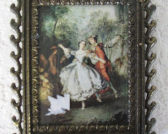 A Vintage metal framed print  dancing couple wall hanging made in Italy