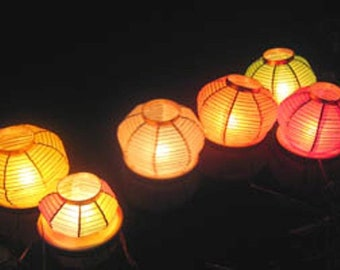 ECO water ,paper ,floating ,night lanterns, a pack of 3 lanterns and 3 tea candles.