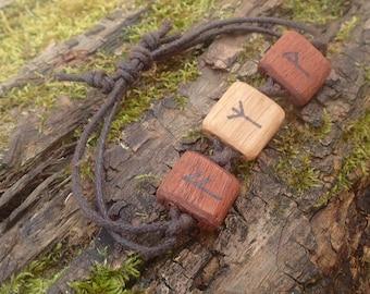 Hand crafted oak and mahogany elder futhark rune bracelet.