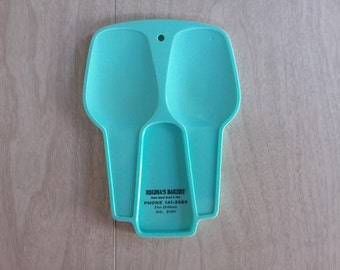 Vintage Turquoise/Teal Colored Spoon Rest Marketing for Reginas Bakery by Arnoldware Rogers Inc