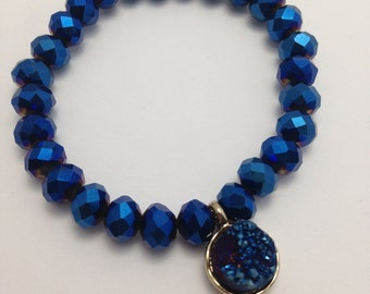 Bracelet blue beveled beads and pendant