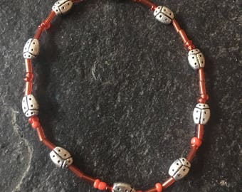 Silver plated ladybug beads with tiny red glass beads - stretchy bracelet