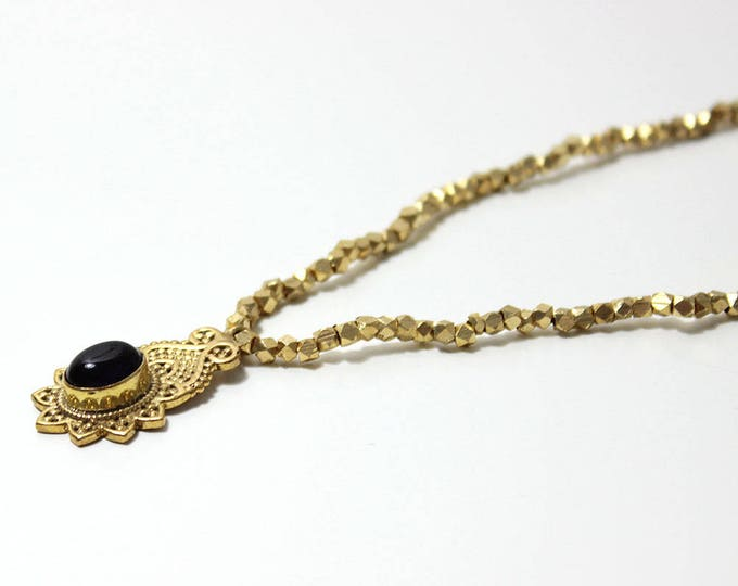 gold with a bohoo pendant necklace