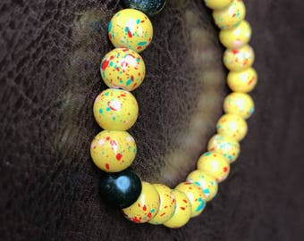Speckled yellow and olive green beaded bracelet
