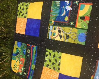 African scenes orange, yellow, green, blue, and black baby quilt