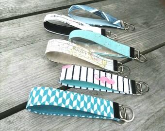 Key strap, key fob, wristlet chain, keyring.
