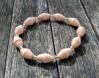 Handmade bracelet with pastel apricot recycled paper and silver glass beads