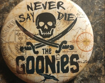 Never say die goonies pin back or bottle opener button