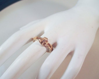 Avon Gold Toned Knot Ring with Diamond