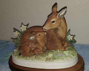 Mother and baby deer on wooden base