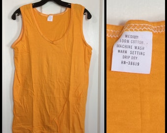 1960s deadstock thin tank top size medium 17.5x26, looks small golden yellow all cotton sportswear basketball gym beach