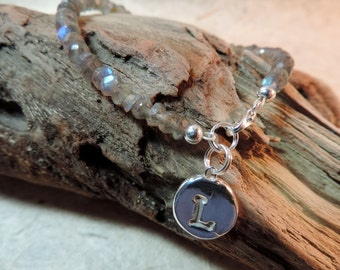 fine silver initial charm ,on a beaded labradorite bracelet .