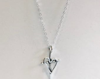 Hand created cross with a heart necklace outline in sterling silver