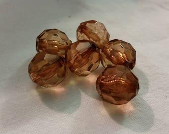 1 large faceted plastic amber 1.5 cm in diameter