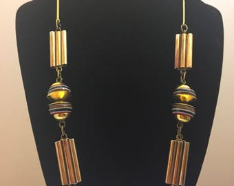 Machine age 1930s gilt metal macaroni tube and bar necklace with sandwich galalith discs - bengel