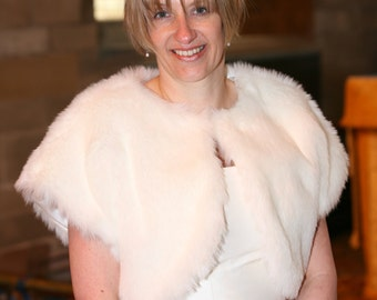 Ivory Bridal fur shrug.