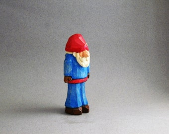 Santa in a blue outfit