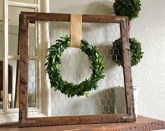 Farmhouse wood frame with preserved boxwood wreath