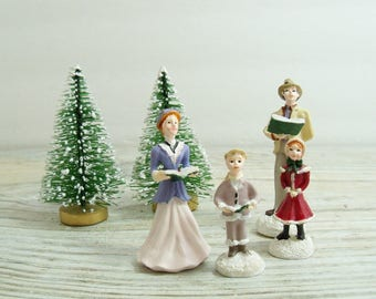 Avon Christmas Family Carollers with Flocked Bottle Brush Trees - Vintage Christmas Village Display, circa 1980s - 6 Pieces