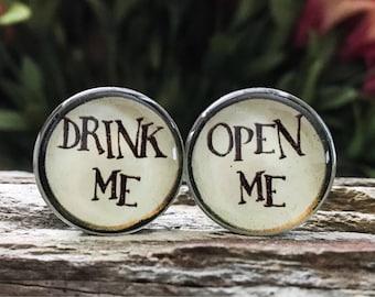 Alice in Wonderland Plugs gauges:  Drink/Open Me  00g, 7/16, 1/2, 9/16, 5/8, 3/4, 7/8, 1 inch