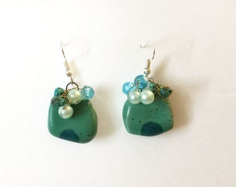 Porcelain earrings with green dot and glass beads